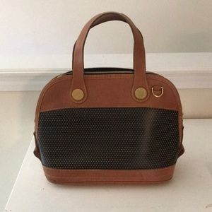Vintage Dooney and Bourks Cabriolet leather purse.